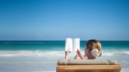TEFL course reading on a Phuket beach